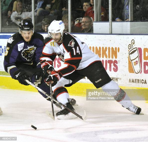 Wednesday March 28 2012 Portland Pirates vs Manchester Monarchs at the Civic Center Pirate Matt Watkins holds off a Monarch defender as he moves on...