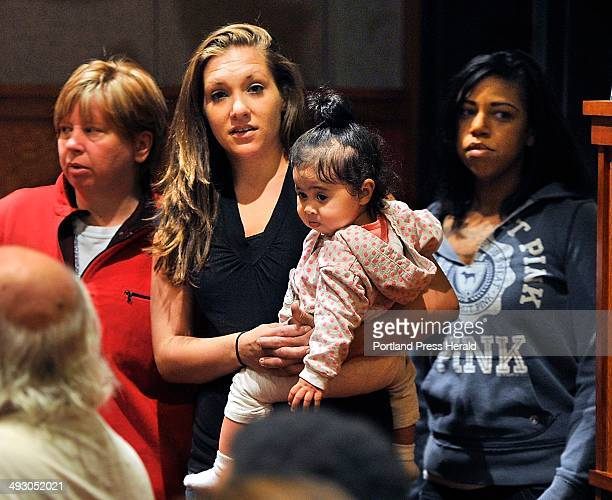Wednesday September 25 2013 Trista Reynolds enters the courtroom with friends and a young girl belonging to a friend prior to Justin DiPietro being...