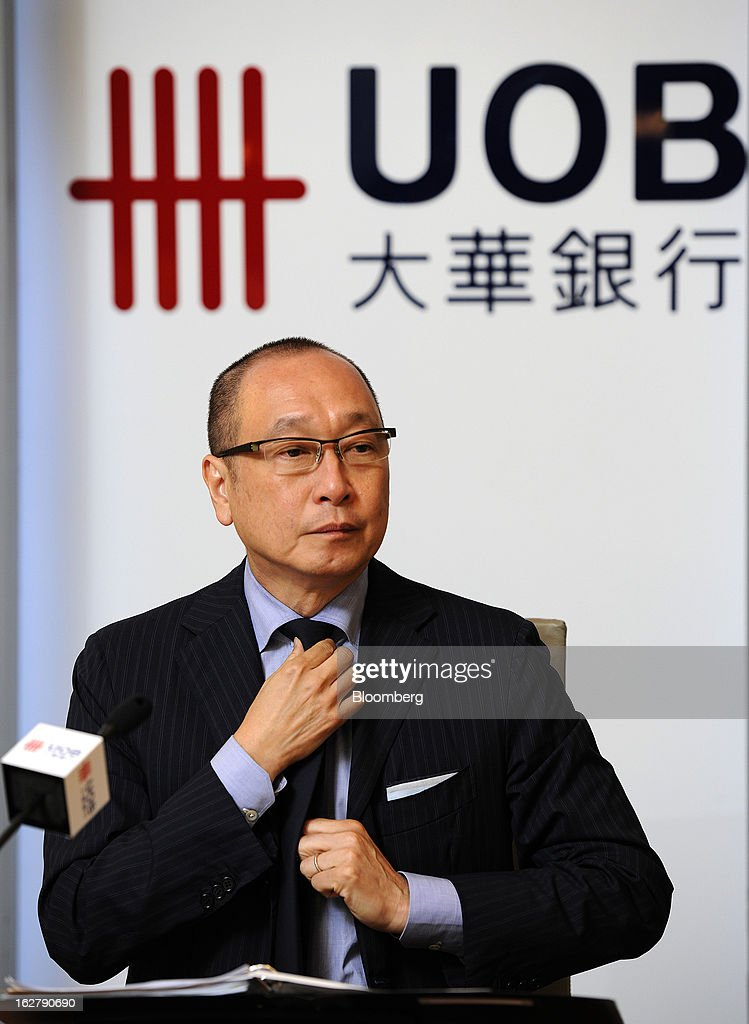 Wee Ee Cheong, chief executive officer of United Overseas Bank Ltd. (UOB), adjusts his tie before speaking at a news conference in Singapore, on Wednesday, Feb. 27, 2013. United Overseas Bank Ltd., Southeast Asia's third-largest lender by assets, said profit rose for a fourth straight quarter on higher income from wealth management and capital markets. Photographer: Munshi Ahmed/Bloomberg via Getty Images