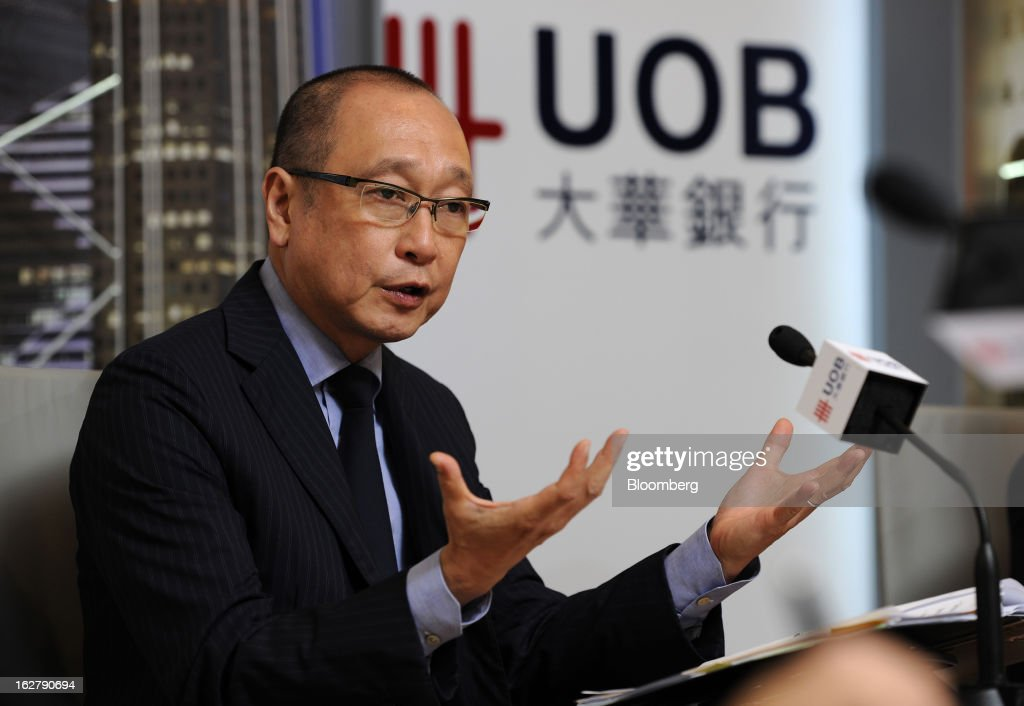 Wee Ee Cheong, chief executive officer of United Overseas Bank Ltd. (UOB), gestures whilst speaking at a news conference in Singapore, on Wednesday, Feb. 27, 2013. United Overseas Bank Ltd., Southeast Asia's third-largest lender by assets, said profit rose for a fourth straight quarter on higher income from wealth management and capital markets. Photographer: Munshi Ahmed/Bloomberg via Getty Images