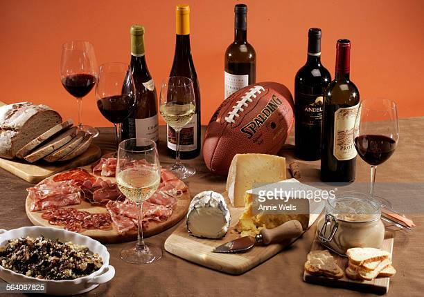Weekly food shoot with super bowl spread with wine cheese meats mushrooms duck rillettes and bread