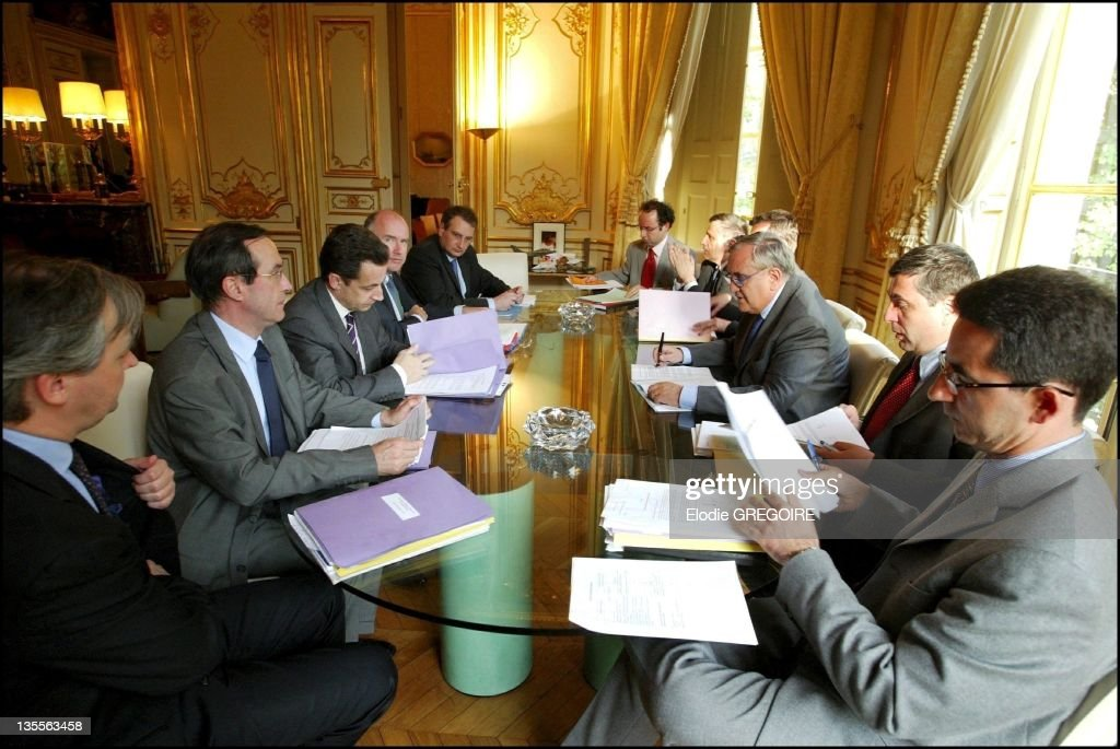 Weekly meeting between the Prime Minister Jean Pierre Raffarin, <a gi-track='captionPersonalityLinkClicked' href=/galleries/search?phrase=Nicolas+Sarkozy&family=editorial&specificpeople=211375 ng-click='$event.stopPropagation()'>Nicolas Sarkozy</a>, <a gi-track='captionPersonalityLinkClicked' href=/galleries/search?phrase=Francois+Perol&family=editorial&specificpeople=3165419 ng-click='$event.stopPropagation()'>Francois Perol</a>, <a gi-track='captionPersonalityLinkClicked' href=/galleries/search?phrase=Claude+Gueant&family=editorial&specificpeople=861764 ng-click='$event.stopPropagation()'>Claude Gueant</a> and <a gi-track='captionPersonalityLinkClicked' href=/galleries/search?phrase=Dominique+Bussereau&family=editorial&specificpeople=722874 ng-click='$event.stopPropagation()'>Dominique Bussereau</a> on May 3, 2004 in Paris, France.