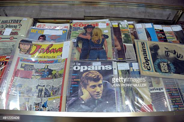Weekly vintage magazines and comic books showing French music icon Johnny Hallyday on their cover are displayed at a Bordeaux auction room...