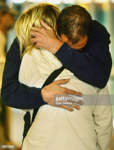 A weeping couple embace after laying a floral tribute at King's Cross Station on July 8 2005 in London England More than 50 people were killed and...