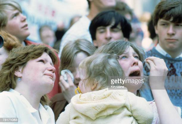Weeping families watch from the quayside as the Cunard liner QE2 carries British troops from Southampton during the Falklands War 12th May 1982