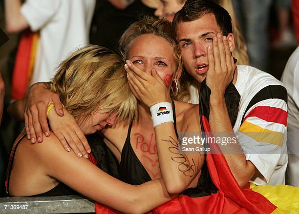 Weeping Germany soccer fans console one another after watching the FIFA World Cup 2006 Semi Finals match between Germany and Italy at the Fan Fest...