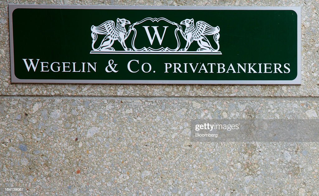 A Wegelin & Co. sign sits in the doorway of the company's offices in Zurich, Switzerland, on Wednesday, March 20, 2013. Wegelin & Co. were ordered to pay U.S. authorities almost $58 million at the end of a criminal case after the Swiss bank pleaded guilty to helping American taxpayers hide more than $1.2 billion from the Internal Revenue Service. Photographer: Gianluca Colla/Bloomberg via Getty Images