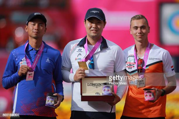 Wei Chun Heng of China Taipei silver medal Im Dong Hyun of Korea gold medal and Steve Wijler of Netherlands bronze medal pose after the Gold Recurve...