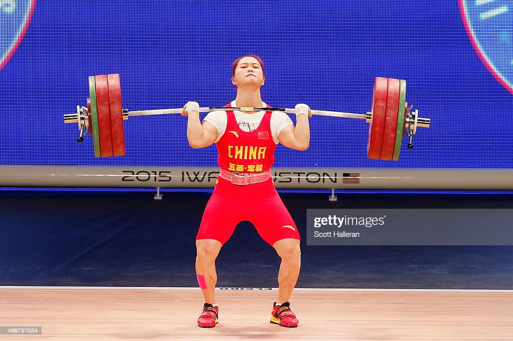 Wei Deng of China breaks the world record with a 146kg clean and Jerk in the women's 63kg weight class during the 2015 International Weightlifting...