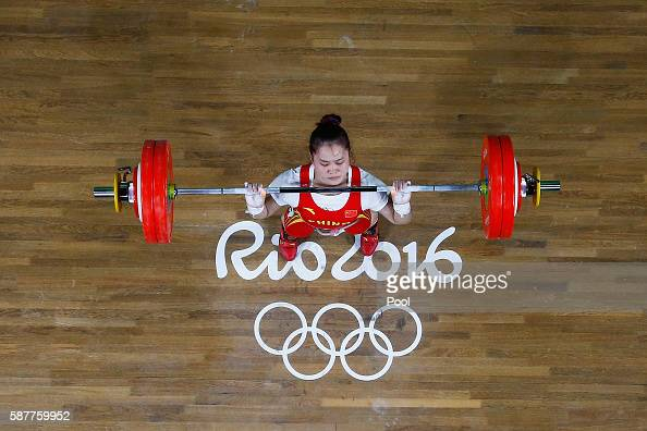 Wei Deng of China lifts to secure winning the gold medal during the Women's 63kg Group A Weightlifting contest on Day 4 of the Rio 2016 Olympic Games...