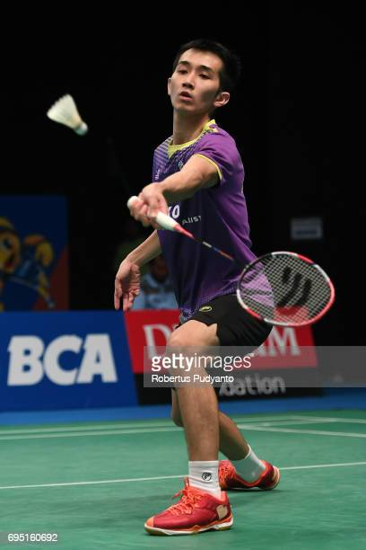 Wei Feng Chong of Malaysia competes against Fabian Roth of Germany during Mens single qualification round match of the BCA Indonesia Open Super...