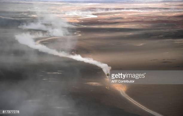 TOPSHOT Wei Han and codriver Liao Mon of China compete during the Stage 10 of the Silk Way 2017 between Hami and Dunhuang China on July 18 2017 / AFP...