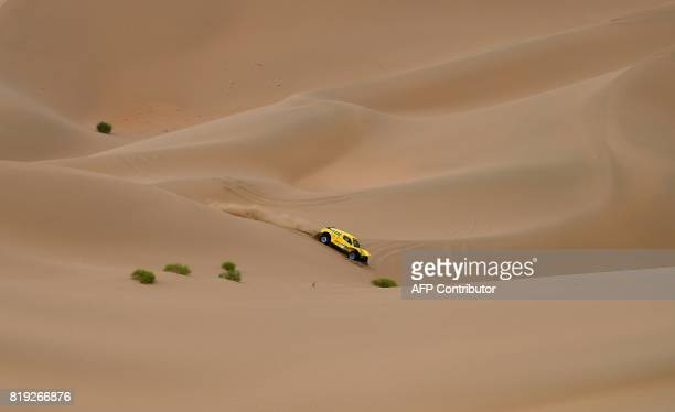 Wei Han and codriver Liao Mon of China ride over sand dunes as they compete during the Stage 12 of the Silk Way 2017 between Jiayuguan and Alxa Youqi...