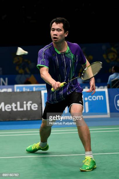 Wei Nan of Hong Kong competes against Ihsan Maulana Mustofa of Indonesia during Mens single qualification round match of the BCA Indonesia Open Super...