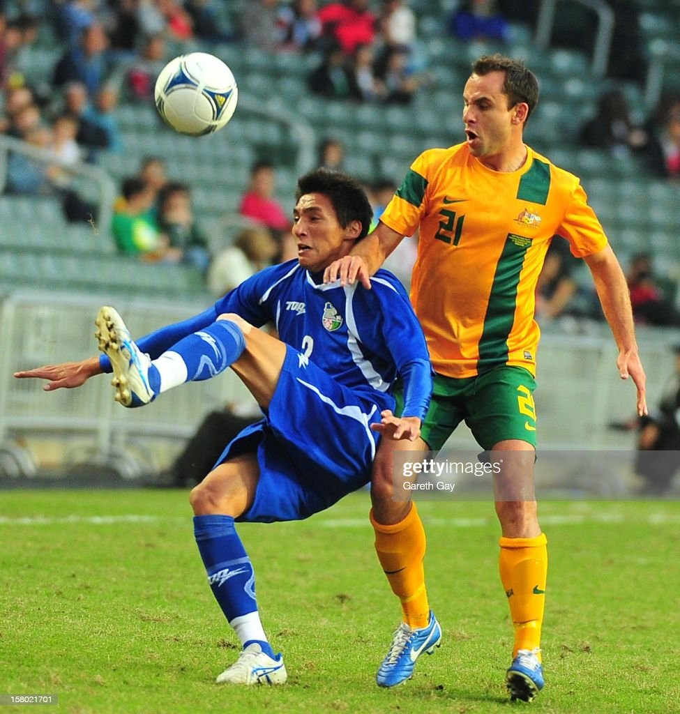 Wei Pei Lun of Chinese Tapei in action with Richard Garcia of Australia during the EAFF East Asian Cup 2013 Qualifying match between Chinese Tapei and the Australian Socceroos at Hong Kong Stadium on December 9, 2012 in So Kon Po, Hong Kong.
