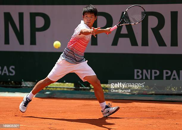 Wei Qiang Zheng of China plays a forehand during his boys' singles match against Young Seok Kim of Republic of Korea during day eight of the French...