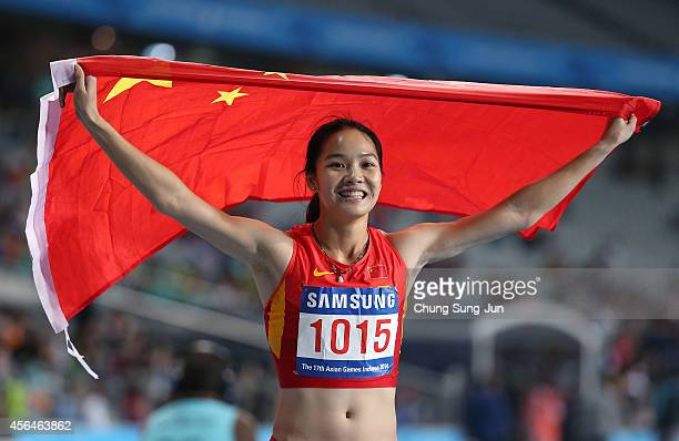 Wei Yongli of China celebrates after the Women's 200m Final on day twelve of the 2014 Asian Games at Incheon Asiad Main Stadium on October 1 2014 in...