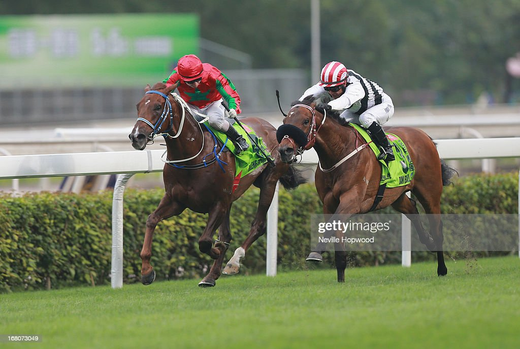 Weichong Marwing rides Dan Excel (R) from Matthew Chadwick on Helene Spirit to win the Group 1 The Champions Mile during The Champions Mile meeting at Sha Tin racecourse on May 5, 2013, in Hong Kong, Hong Kong.