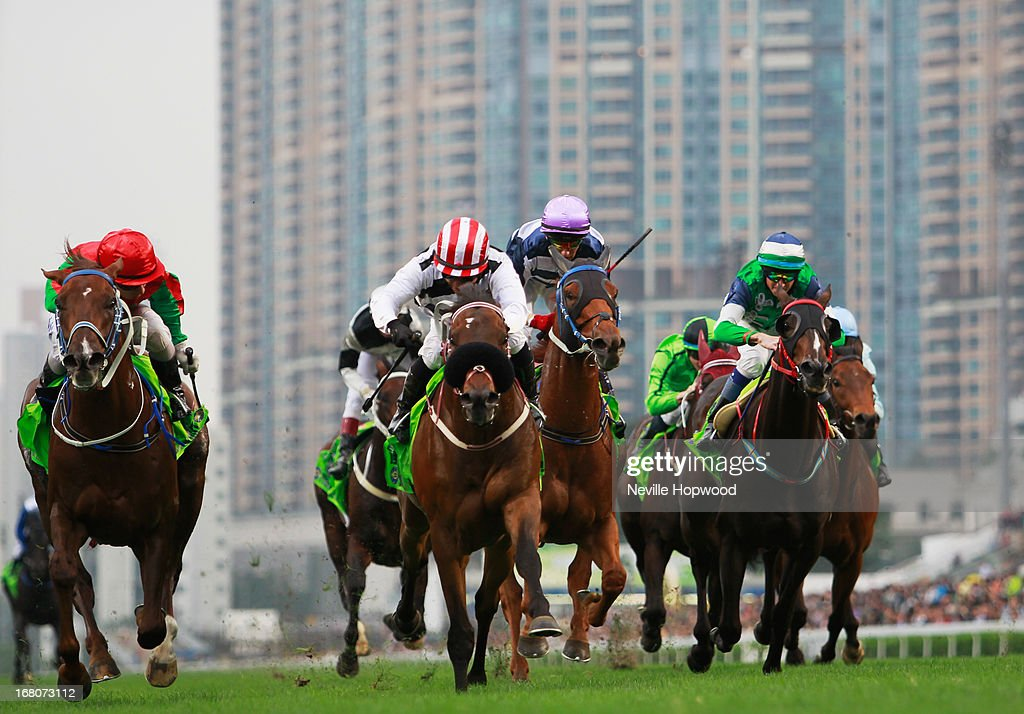 Weichong Marwing rides Dan Excel (right, red and white striped cap) from Matthew Chadwick on Helene Spirit to win the Group 1 The Champions Mile during The Champions Mile meeting at Sha Tin racecourse on May 5, 2013, in Hong Kong, Hong Kong.