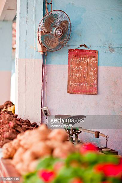 Weighing scale at vegetable market stand