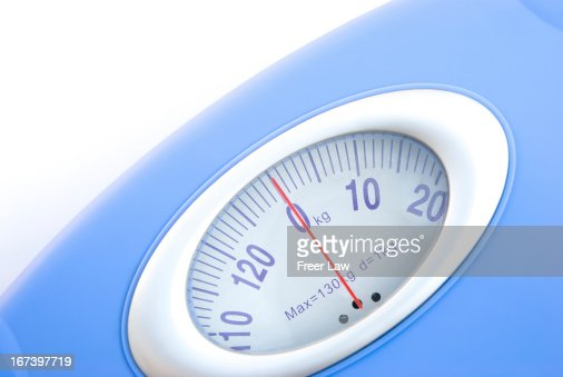 weight scale close up on white : Stock Photo