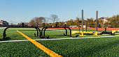 Both push and pull sleds are on a green turf field ready for strength and speed training.