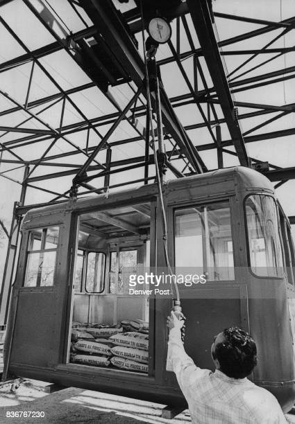 Weighted With Three Tons Of Sand Cabin Is Lifted Off Ground For Test Capacity Of Cabin Is 35 Adults Weight's Read On Dial From Telescope On Ground...