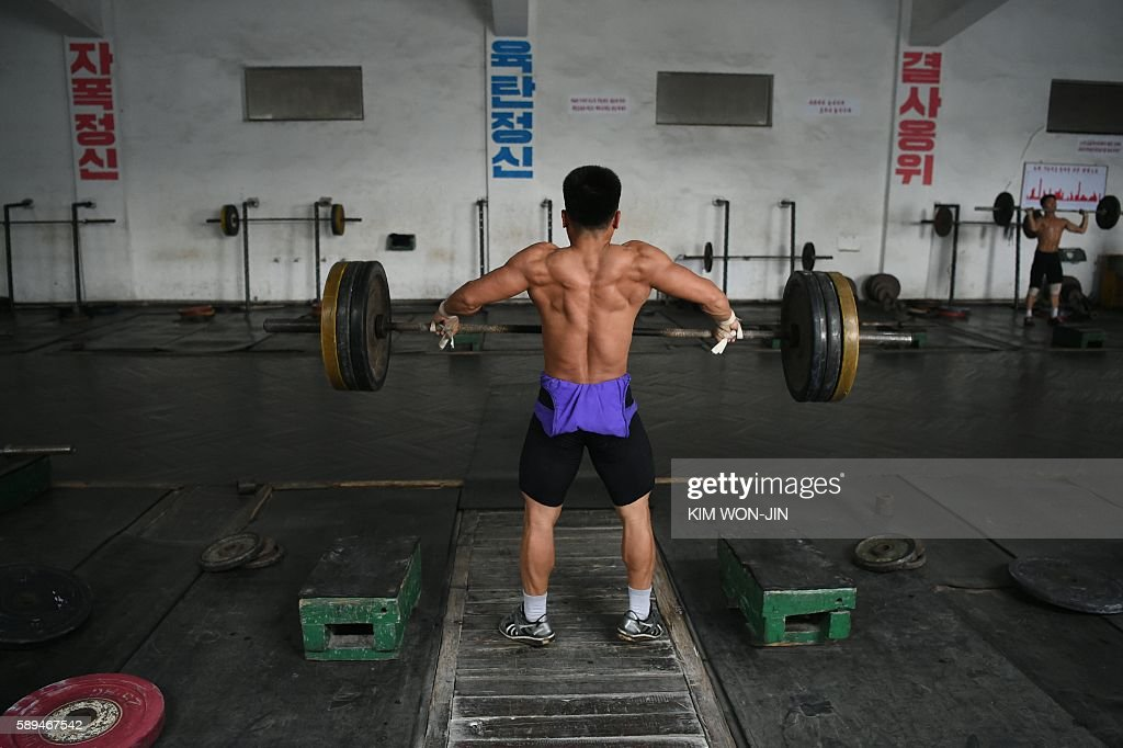 A weightlifter trains at the Kigwancha Sports Team gym the home facility where North Korean weightlifter Rim JongSim who won gold at the 2012 Olympic...
