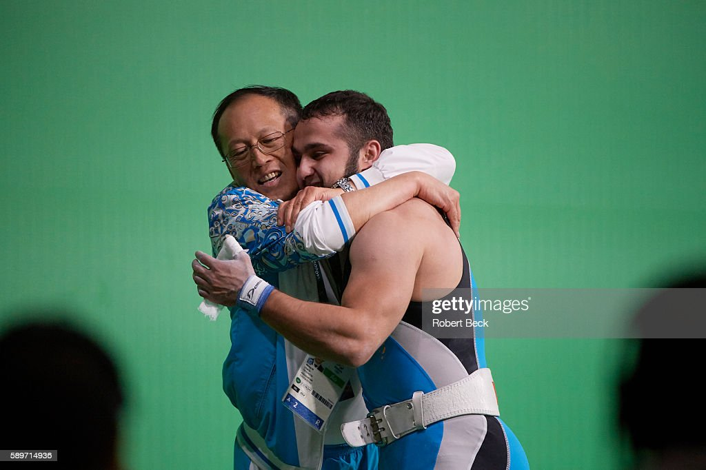 2016 Summer Olympics Kazakhstan Nijat Rahimov victorious hugging his coach after winning Men's 77kg Preliminary Round Group A Final at Riocentro...
