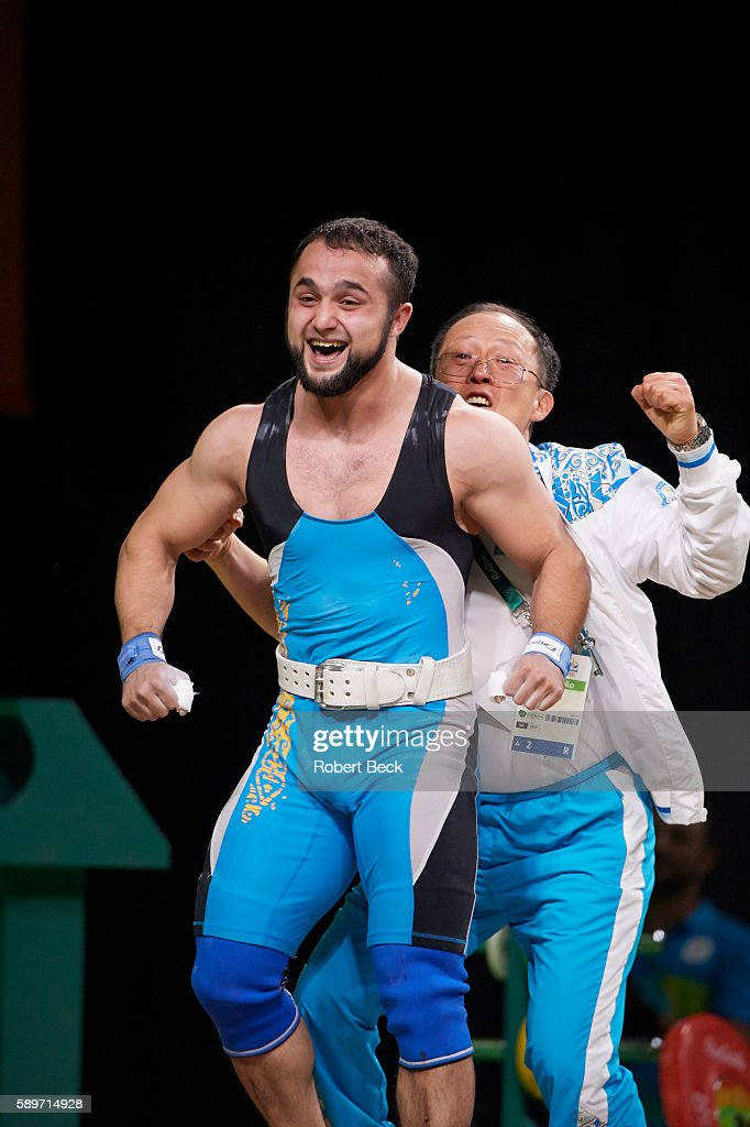 2016 Summer Olympics Kazakhstan Nijat Rahimov victorious with his coach behind him after winning Men's 77kg Preliminary Round Group A Final at...