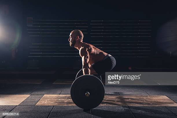 weightlifting strong man on a gym