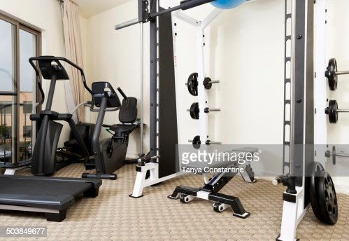 Weights and exercise machines in gym