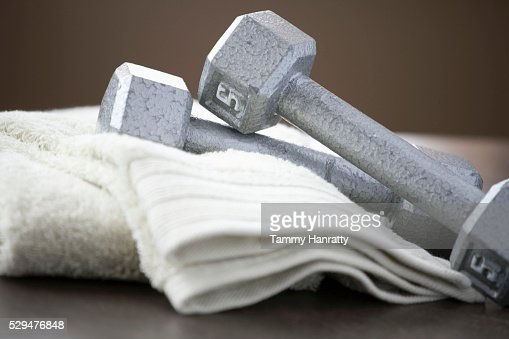Weights and towels : Stock Photo