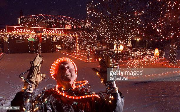 Robert Green of 754 Eyer Dr Pickering stands in front of his home lit by thousands of Christmas lights December 11 2000 The hydro bill for the month...