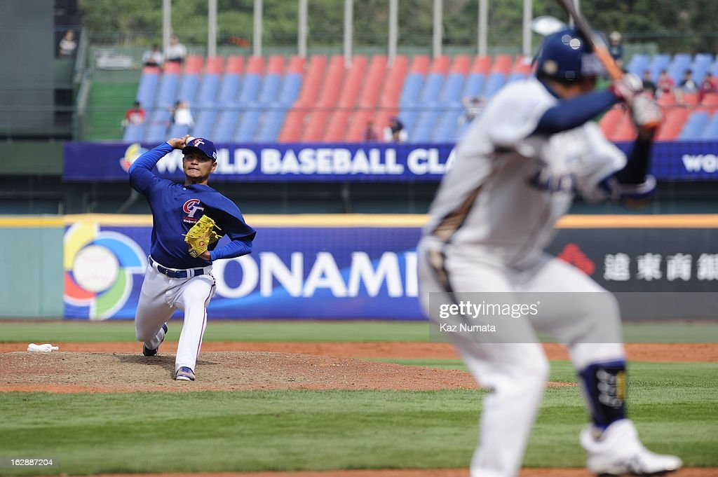 Wei-Lun Pan #18 of Team Chinese Taipei pitches during the World Baseball Classic exhibition game against the NC Dinos at Taichung Intercontinental Baseball Stadium on Thursday, February 28, 2013 in Taichung, Tawain.