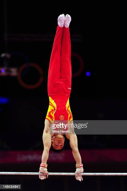 Weiyang Gao of China performs on the Artistic Gymnastics Men's Horizontal Bar on day one of the London 2012 Olympic Games at North Greenwich Arena on...