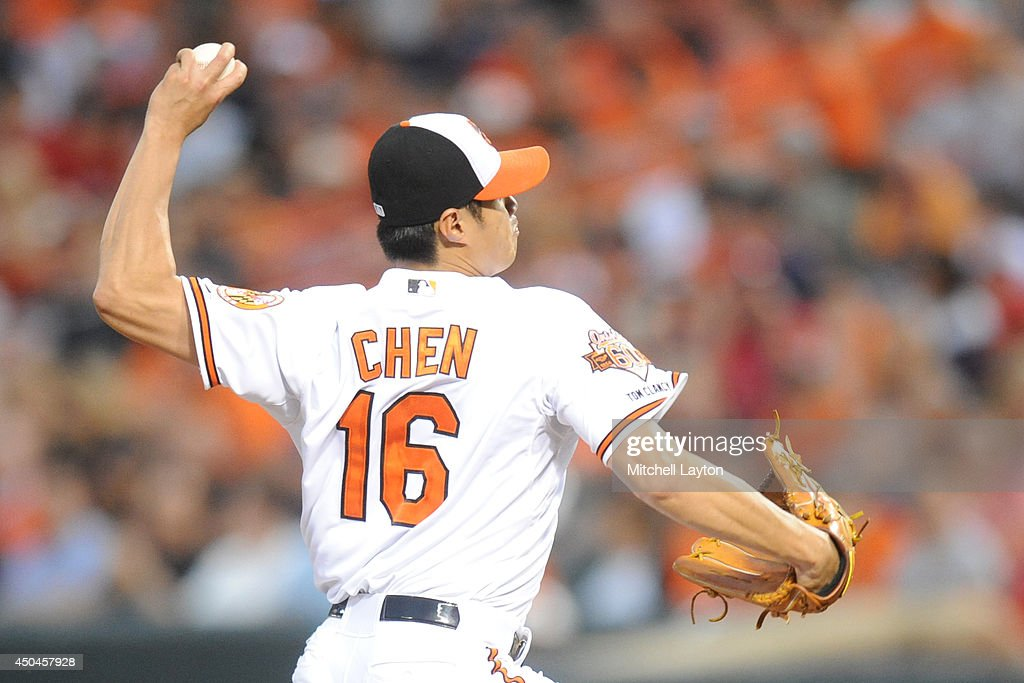 Wei-Yin Chen #16 of the Baltimore Orioles pitches in first inning during a baseball game against the Boston Red Sox on June 11, 2014 at Oriole Park at Camden Yards in Baltimore, Maryland.