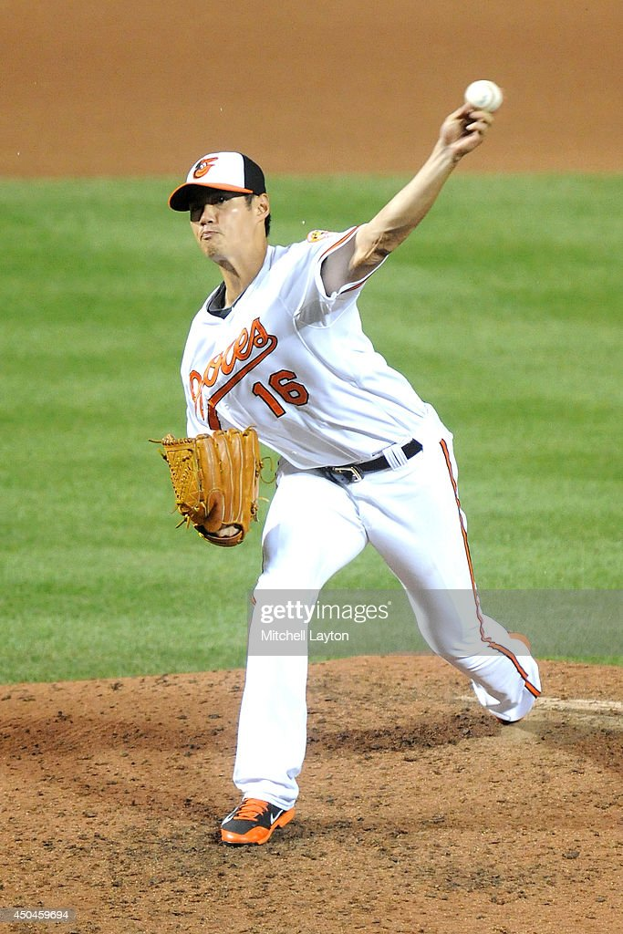 Wei-Yin Chen #16 of the Baltimore Orioles pitches in the seventh inning during a baseball game against the Boston Red Sox on June 11, 2014 at Oriole Park at Camden Yards in Baltimore, Maryland.
