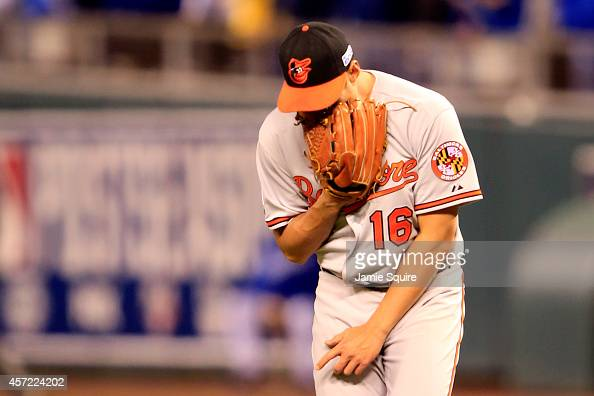 WeiYin Chen of the Baltimore Orioles reacts after Alex Gordon of the Kansas City Royals hit a grounder out to second base in the fourth inning to...