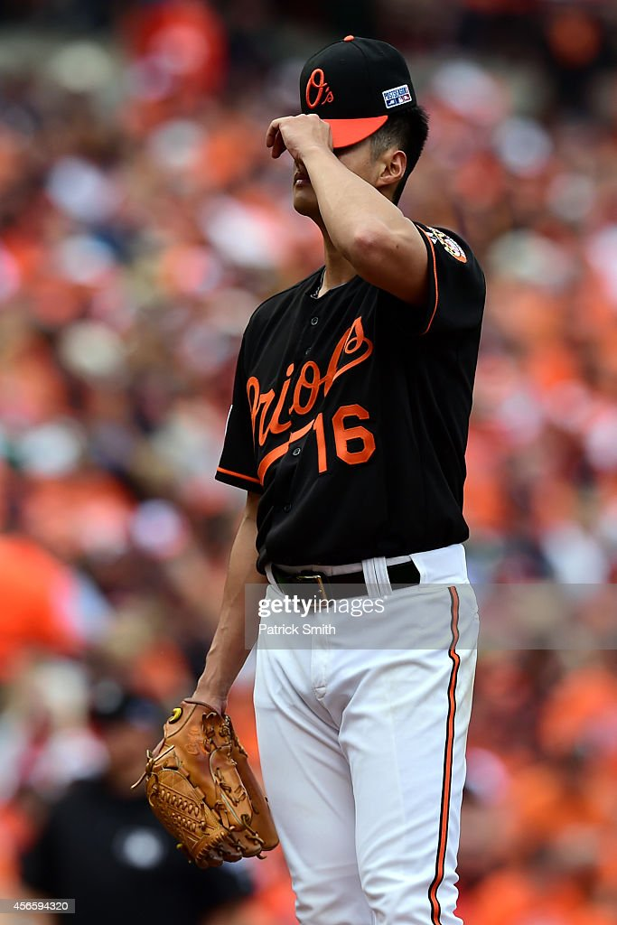 <a gi-track='captionPersonalityLinkClicked' href=/galleries/search?phrase=Wei-Yin+Chen&family=editorial&specificpeople=8958243 ng-click='$event.stopPropagation()'>Wei-Yin Chen</a> #16 of the Baltimore Orioles reacts after J.D. Martinez #28 of the Detroit Tigers hit a three run home run scoring Miguel Cabrera #24 and Victor Martinez #41 in the fourth inning during Game Two of the American League Division Series at Oriole Park at Camden Yards on October 3, 2014 in Baltimore, Maryland.