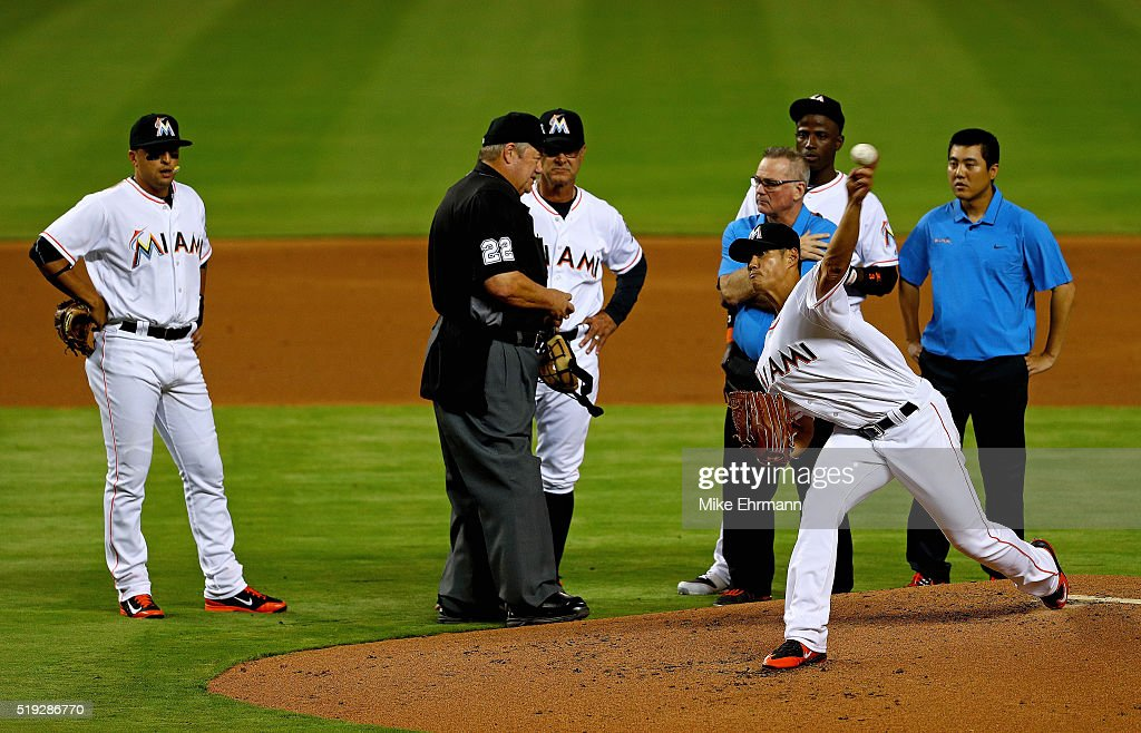 Wei-Yin Chen #54 of the Miami Marlins is looked at by manager Don Mattingly #8 after being hit during 2016 Opening Day against the Detroit Tigers at Marlins Park on April 5, 2016 in Miami, Florida.