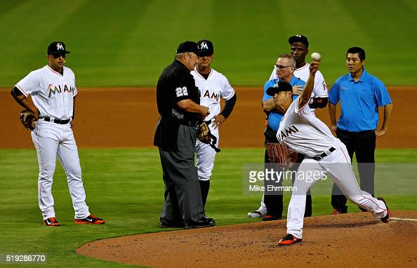 WeiYin Chen of the Miami Marlins is looked at by manager Don Mattingly after being hit during 2016 Opening Day against the Detroit Tigers at Marlins...