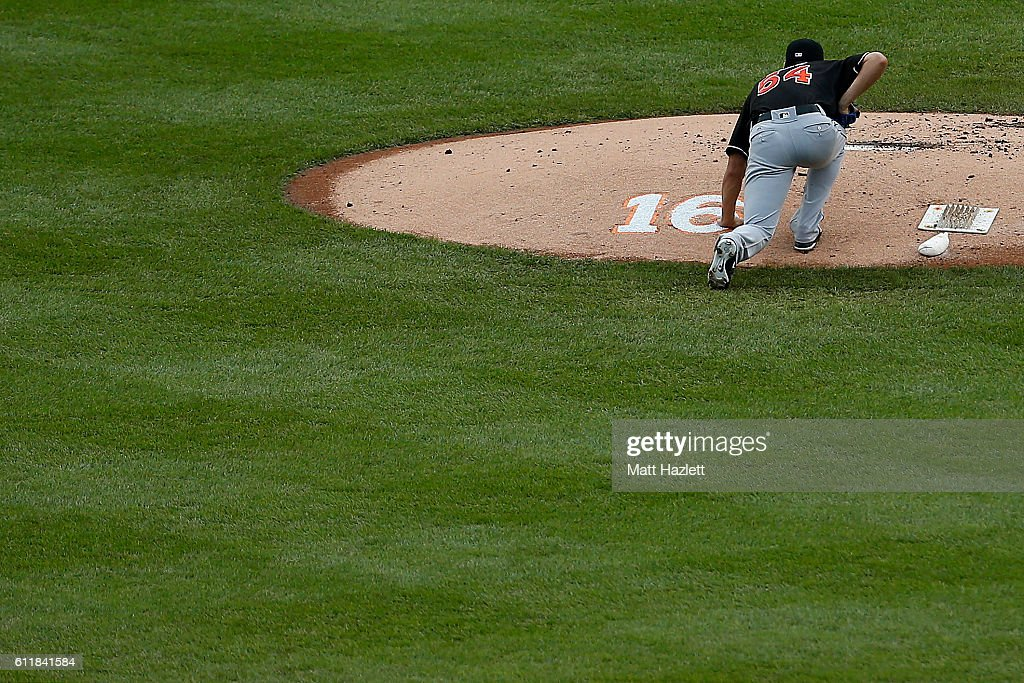 Wei-Yin Chen #54 of the Miami Marlins touches a number 16 memorializing Miami Marlins pitcher Jose Fernandez, who died in a boating accident, on the pitchers mound in the first inning against the Washington Nationals at Nationals Park on October 1, 2016 in Washington, DC.