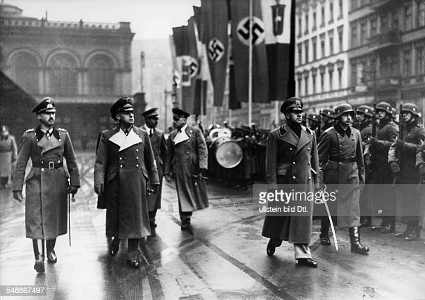 Welcome ceremony on the square in front of the Anhalter Bahnhof in Berlin the italian foreign minister Galeazzo Count Ciano taking the salute of a...