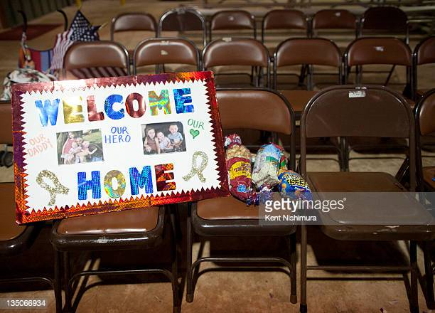 A welcome home sign is displayed as soldiers of the 25th Infantry Division are greeted by family friends and loved ones at the Second 25th Infantry...