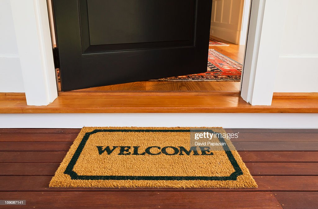 welcome mat and front door stock photo