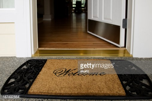 Welcome mat entrance new home door wood floor clean inviting