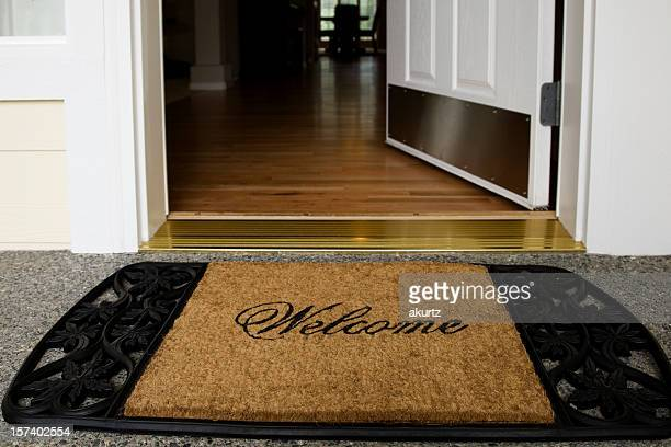 Welcome mat entrance new home door wood floor clean inviting