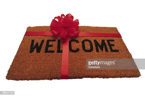 Welcome mat with ribbon and bow