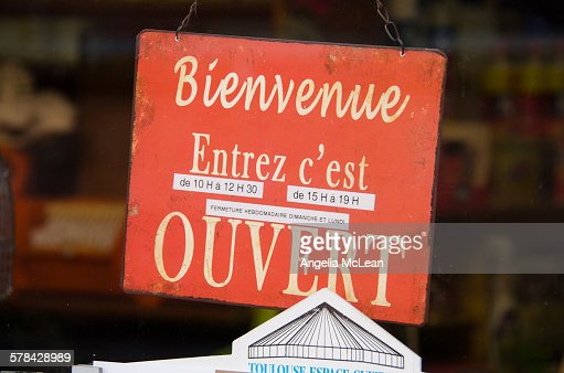Welcome Open Sign in French Hanging on door